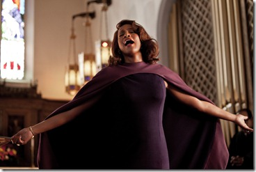 Emma (Whitney Houston) singing in church in TriStar Pictures' SPARKLE.