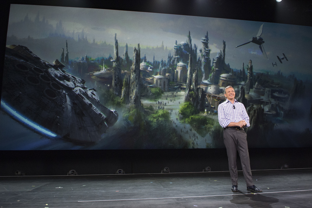 D23 EXPO 2015 - Bob Iger Announces Star Wars-Themed Lands Coming to Disney Parks - Walt Disney Company Chairman and CEO Bob Iger announced at D23 EXPO 2015 that Star Wars-themed lands will be coming to Disneyland park in Anaheim, Calif., and Disney's Hollywood Studios in Orlando, Fla., creating Disney's largest single-themed land expansions ever at 14-acres each, transporting guests to a never-before-seen planet, a remote trading port and one of the last stops before wild space where Star Wars characters and their stories come to life. These authentic lands will have two signature attractions, including the ability to take the controls of one of the most recognizable ships in the galaxy, the Millennium Falcon, on a customized secret mission, and an epic Star Wars adventure that puts guests in the middle of a climactic battle. (Disney Parks/Image Group LA)  ROBERT A. IGER (Chairman and Chief Executive Officer, The Walt Disney Company)