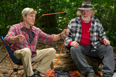 """This photo provided by Broad Green Pictures shows, Robert Redford, left, as Bill Bryson and Nick Nolte as Stephen Katz taking in the view along the Appalachian Trail in the film, """"A Walk in the Woods."""" The movie releases in U.S. theaters on Sept. 2, 2015.  (Frank Masi, SMPSP/Broad Green Pictures via AP)"""