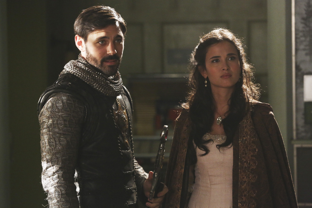 "ONCE UPON A TIME - ""The Broken Kingdom"" - After receiving a cryptic warning from Lancelot about Arthur's intentions, Mary Margaret realizes Arthur may be the heroes' biggest threat, but when she is unable to convince David of the danger, she takes matters into her own hands. Meanwhile, Hook's unwavering love for Emma provides a glimmer of hope in her struggle against the unrelenting voice of Rumplestiltskin. In a Camelot flashback, Guinevere senses that Arthur is losing his way, consumed by his obsession with making Excalibur whole, so she sets out with Lancelot on her own quest into the heart of darkness. In Storybrooke, Dark Emma unleashes a secret weapon in the next phase of her plan to find the brave soul she needs to draw Excalibur from the stone, on ""Once Upon a Time,"" SUNDAY, OCTOBER 18 (8:00-9:00 p.m., ET) on the ABC Television Network. (ABC/Jack Rowand) LIAM GARRIGAN, JOANA METRASS"