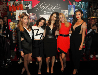 "PRETTY LITTLE LIARS - Lucy Hale, Shay Mitchell, Ashley Benson, Troian Bellisario and Sasha Pieterse as well as Executive producers Marlene King, Oliver Goldstick and Joseph Dougherty assemble at Comic-Con New York to preview the new mystery facing the girls when ""Pretty Little Liars"" returns in January 2016.  (ABC Family/Lou Rocco) ASHLEY BENSON, LUCY HALE, TROIAN BELLISARIO, SASHA PIETERSE, SHAY MITCHELL"