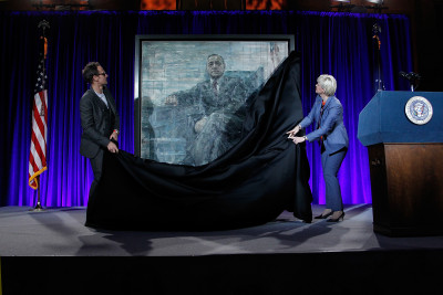"WASHINGTON, DC - FEBRUARY 22: Artist Jonathan Yeo (L) and Portrait Gallery Director Kim Sajet unveil a portrait on stage at the portrait unveiling and season 4 premiere of Netflix's ""House Of Cards"" at the National Portrait Gallery on February 22, 2016 in Washington, DC.  (Photo by Paul Morigi/Getty Images For Netflix)"